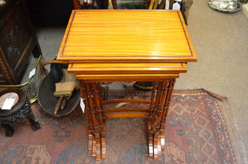 Nest of four satinwood tables