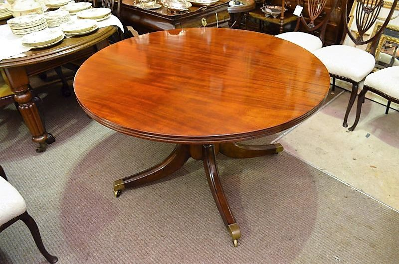 Irish mahogany centre table on brass castors.